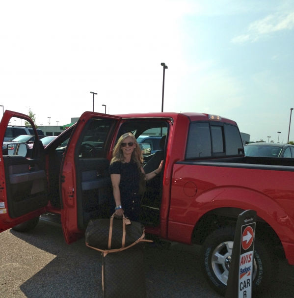 A girlfriend will agree that a completely impractical quad cab red pick up is the JUST RIGHT rental for no good reason