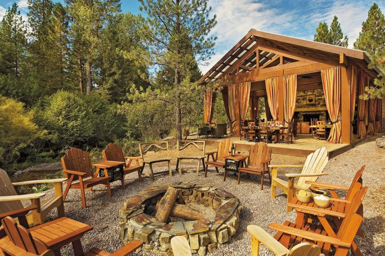 Campfire and adirondack chairs at The Resort at Paws Up